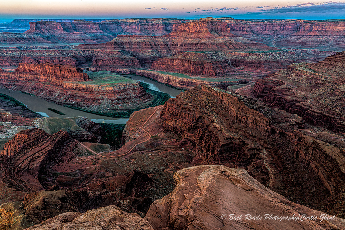 Well before sunrise I drove out to Dead Horse Point and hiked out to the point in order to find a good spot to set up.  It is...