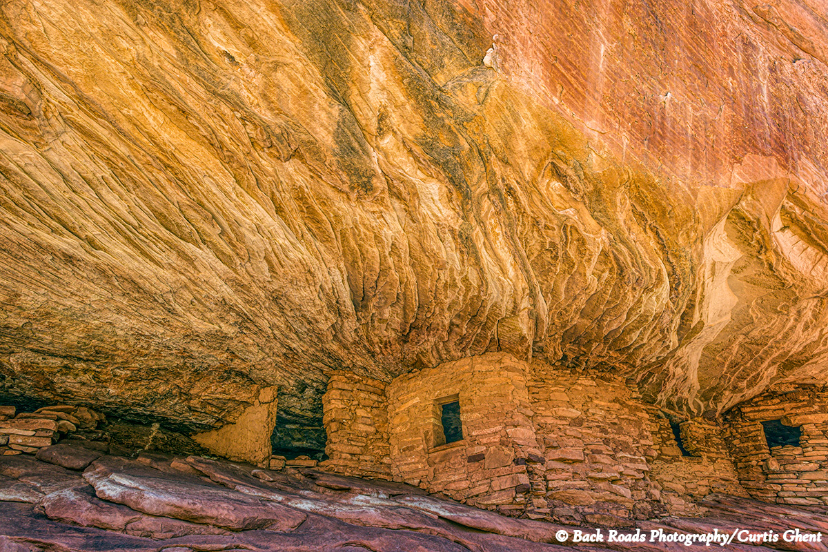 Located under a large caprock the morning light gives the impression that the ruin is on fire.