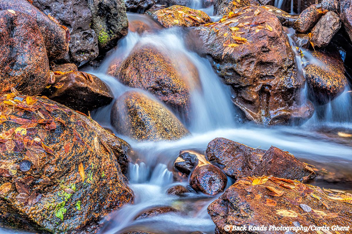 While wandering around in the backcountry of Rocky Mountain National Park I came across the little water fall covered with the...
