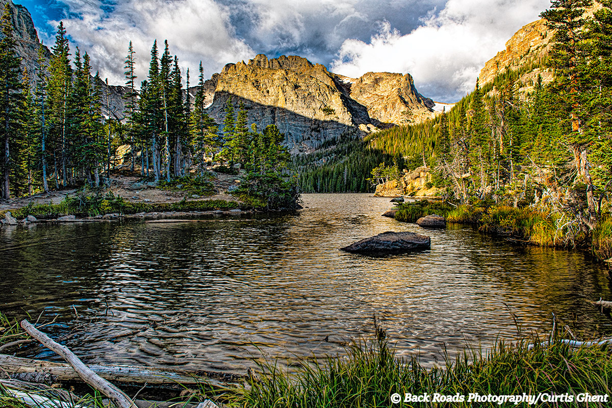 Early this morning I sat on the bank of the backcountry lake and watch as the day slowly began and the clouds building for a...