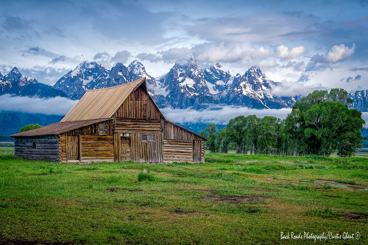 Moulton Barn with the Tetons in the background basking in the morning light.