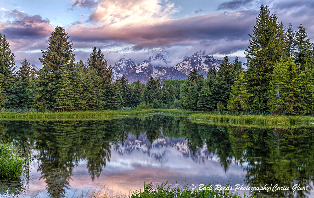 A calm beaver pond give a nice reflection at sunrise to the Tetons.